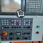Универсально-фрезерный обрабатывающий центр с ЧПУ Microcut VMC-2100